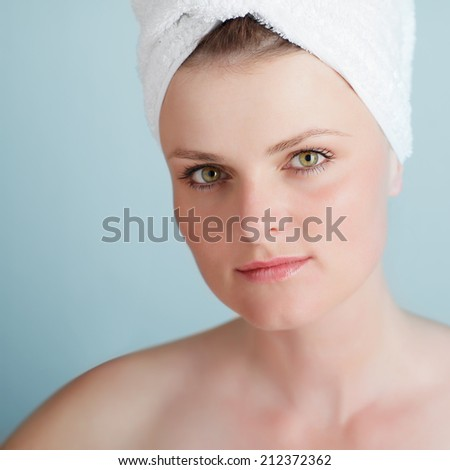 portrait of a beautiful woman with a towel on her head - stock photo