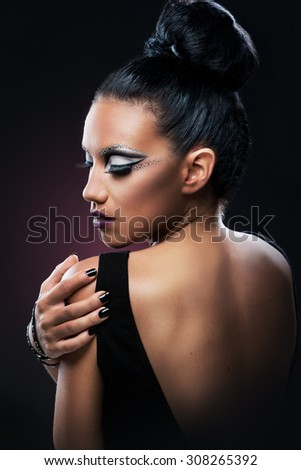 Portrait of a beautiful woman with an amazing make up, back - stock photo