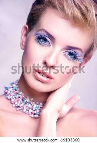 Portrait of a beautiful woman with beautiful makeup isolated on white - stock photo