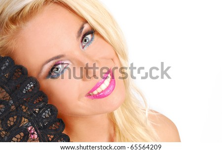 Portrait of a beautiful woman with black fan - stock photo