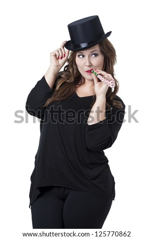 Portrait of a beautiful woman with black hat and party horn blower