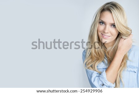 Portrait of a beautiful woman with blond hair - stock photo