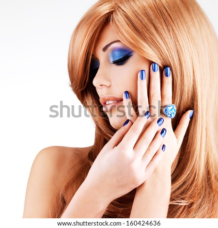 portrait of a beautiful woman with blue nails, blue makeup and red hairs  on white  background - stock photo