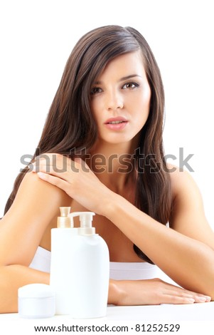 Portrait of a beautiful woman with cream and shower gel - stock photo
