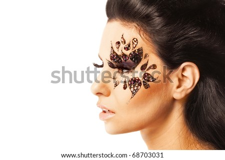 portrait of a beautiful woman with Creative Fashion Makeup.Holiday Make-up on white background
