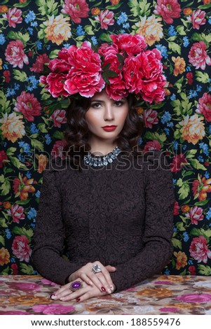 Portrait of a beautiful  woman with flowers in her hair. Fashion photo - stock photo