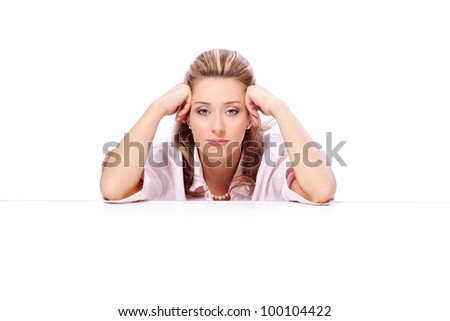 Portrait of a beautiful woman with hands beside head - stock photo