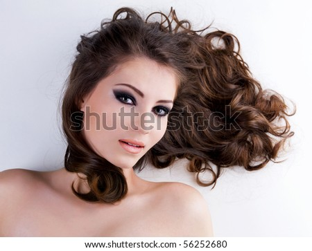 Portrait of a beautiful  woman with  long brown hairs - stock photo