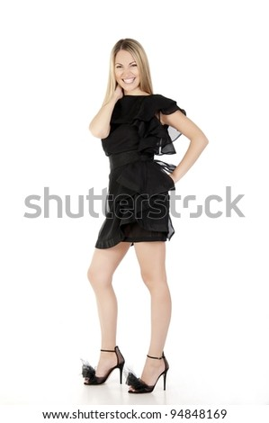 Portrait of a beautiful woman with long hairs in black dress on white background