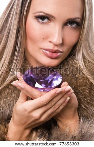 Portrait of a beautiful woman with precious jewel - stock photo