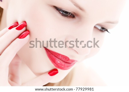 Portrait of a beautiful woman with red lips and nails