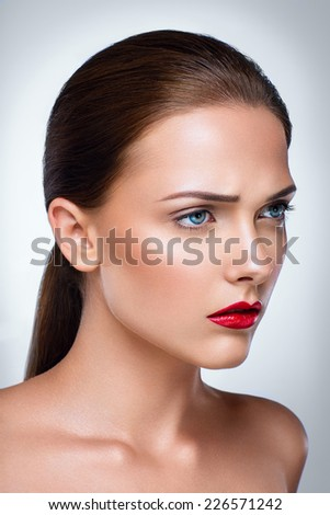 Portrait of a beautiful woman with skin care  - stock photo