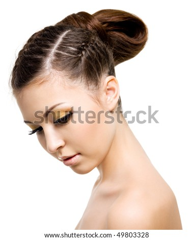 Portrait of a beautiful woman with style hairstyle of pigtail. On white background - stock photo