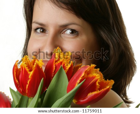 Portrait of a beautiful woman with tulips