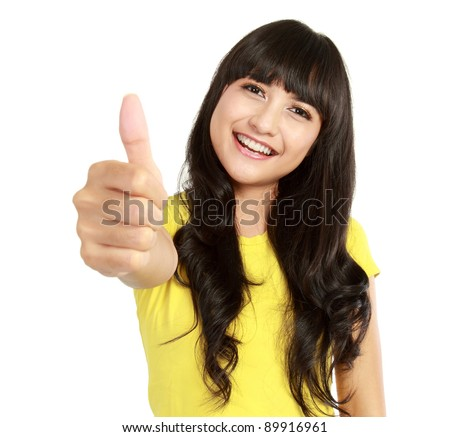 Portrait of a beautiful young asian woman showing thumbs up. Isolated on white background - stock photo