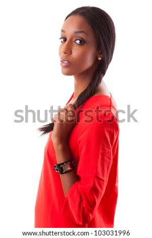 Portrait of a beautiful young black woman in red dress, isolated on white background