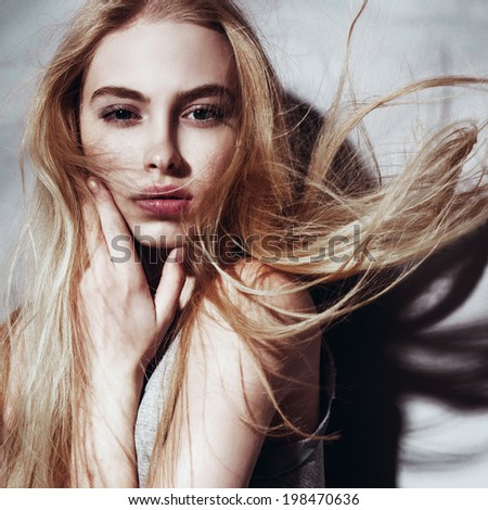 Portrait of a beautiful young blonde girl with developing hair, close up - stock photo