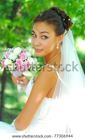 portrait of a beautiful young bride in a white dress - stock photo