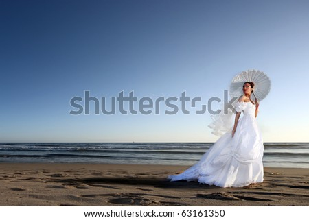 Portrait of a Beautiful Young Bride on her Wedding Day - stock photo