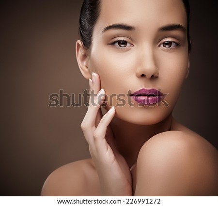 Portrait of a beautiful young brunette. - stock photo