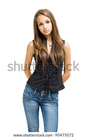 Portrait of a beautiful young brunette girl  posing in jeans isolated on white background. - stock photo
