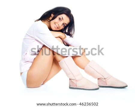 portrait of a beautiful young brunette woman wearing winter boots - stock photo