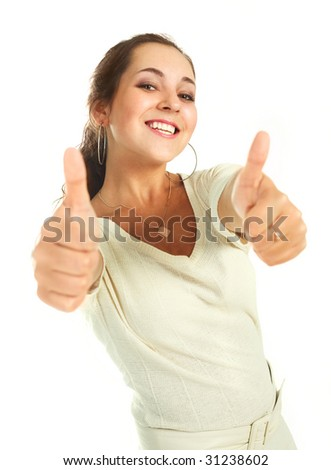 portrait of a beautiful young brunette woman with her thumbs up - stock photo
