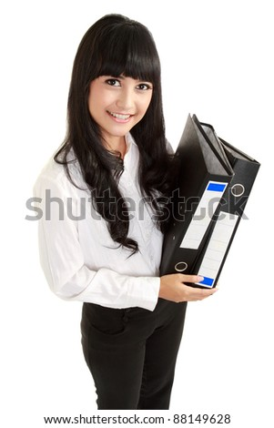 Portrait of a beautiful young business woman holding a folder, full length in isolated background - stock photo