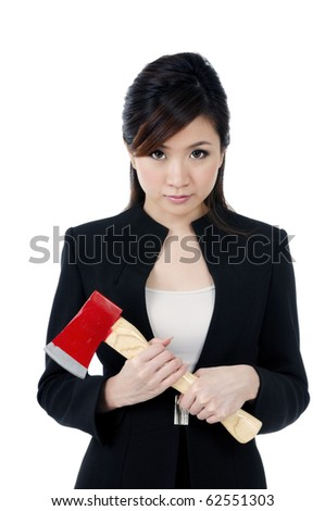 Portrait of a beautiful young businesswoman carrying an axe, isolated on white background.