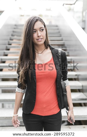 Portrait of a beautiful young businesswoman down stairs
