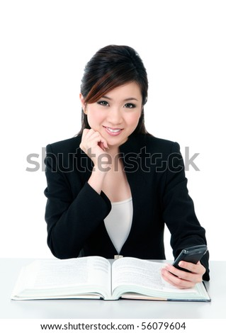 Portrait of a beautiful young businesswoman holding a mobile phone over white background. - stock photo