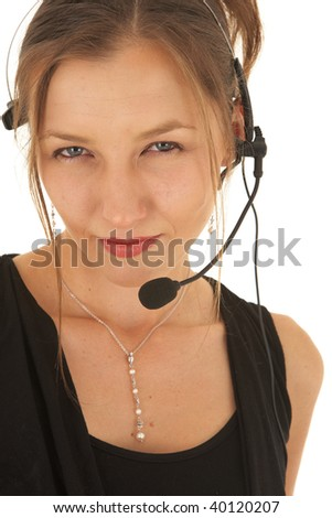 Portrait of a beautiful young Caucasian businesswoman wearing phone headset on white background. NOT ISOLATED - stock photo