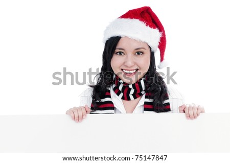 Portrait of a beautiful young Christmas woman holding blank sign, isolated on white.