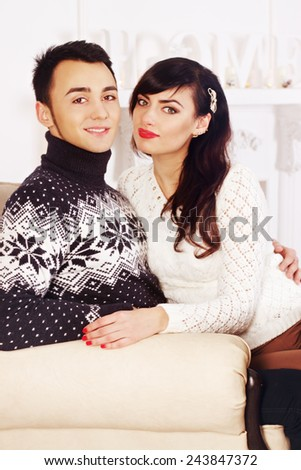 portrait of a beautiful young couple on a background of fire - stock photo