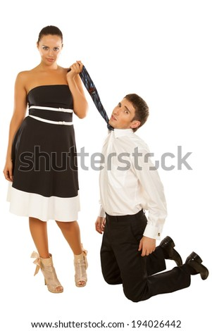 Portrait of a beautiful young couple, the girl holds the tie guy kneeling - stock photo