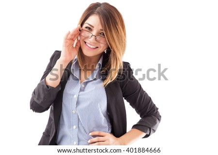 Portrait of a beautiful young English teacher wearing glasses and smiling on a white background - stock photo