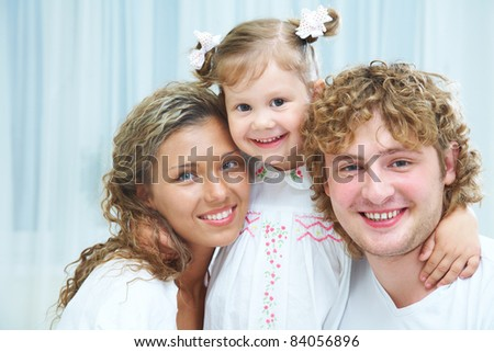 Portrait of a beautiful young family have a good time at home - stock photo