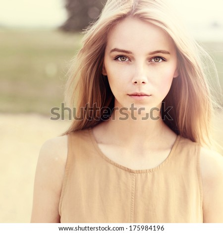 portrait of a beautiful young girl closeup. Shooting on a sunny day at the beach - stock photo
