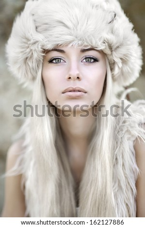 portrait of a beautiful young girl in fur - stock photo