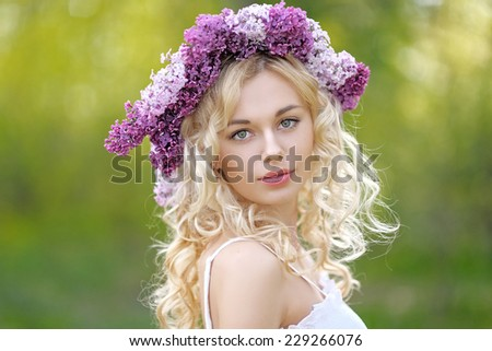 portrait of a beautiful young girl in spring - stock photo