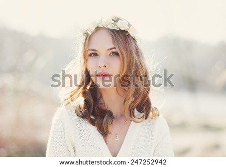 portrait of a beautiful young girl in the spring - stock photo
