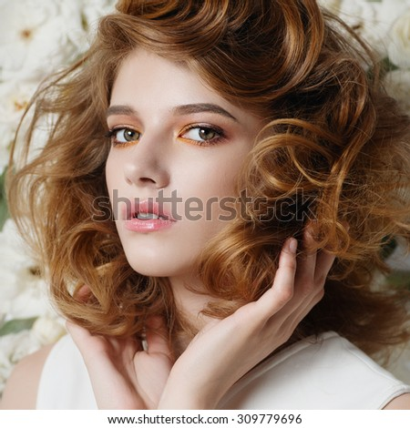 Portrait of a beautiful young girl on a background of white flowers, the concept of beauty and health - stock photo