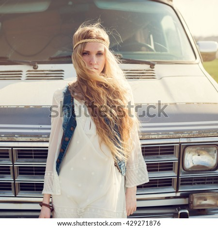 portrait of a beautiful young girl on the background of retro bus