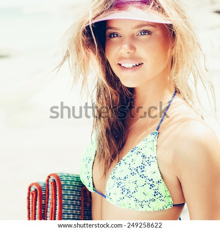 portrait of a beautiful young girl on the beach. outdoors lifestyle - stock photo