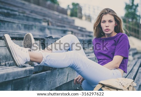 portrait of a beautiful young  girl  outdoors at the day time