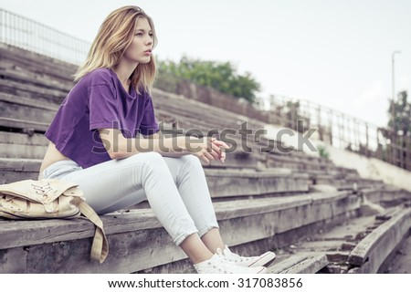 portrait of a beautiful young  girl  outdoors at the day time - stock photo