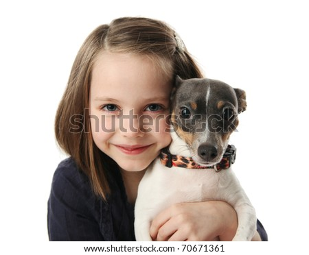 Portrait of a beautiful young girl snuggling with a cute terrier puppy dog, isolated on white in studio - stock photo