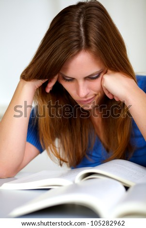 Portrait of a beautiful young girl studying at office indoor