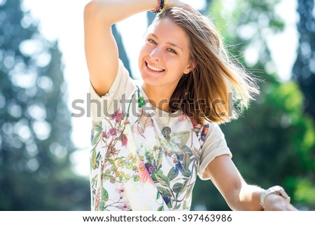 Portrait of a beautiful young girl with a sweet smile. The concept of joy and fun