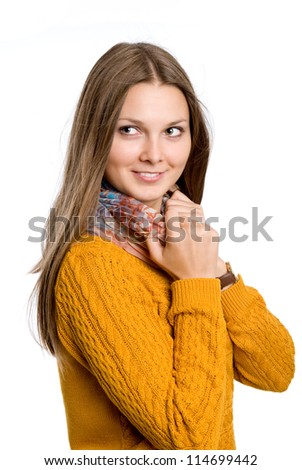 Portrait of a beautiful young girl with blond hair- isolated on white.A girl in a sweater - stock photo
